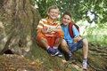 Two Boys Geocaching In Woodland Royalty Free Stock Photo