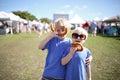 Two boys Having Fun Eating Pretzles at Farmer`s Market Royalty Free Stock Photo