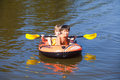 Two Boys Having Fun on Inflatable Rubber Boat Royalty Free Stock Photo