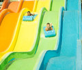 Two boys having fun in waterslide child s water slide aqua park Royalty Free Stock Photos