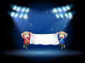 Two boys holding a banner under the spotlights illustration of Stock Photo