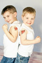 Two boys with i love mom valentine heart tatoos showing off their tattoos Stock Image
