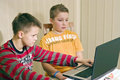 Two boys and laptop computer Royalty Free Stock Photo