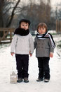 Two boys in the park with lantern snow Stock Photos