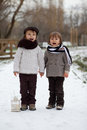 Two boys in the park with lantern snow Royalty Free Stock Images