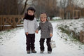 Two boys in the park with lantern snow Royalty Free Stock Photography