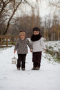 Two boys in the park with lantern snow Royalty Free Stock Photo