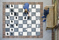 Two boys playing outdoor chess Royalty Free Stock Photo