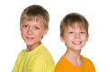 Two boys a portrait of smiling young against the white background Royalty Free Stock Images