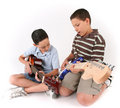 Two boys singing and playing Royalty Free Stock Photos