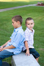 Two Boys Sitting Royalty Free Stock Photos
