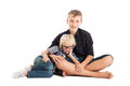 Two boys sitting floor isolated Royalty Free Stock Photo