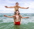 Two boys strike a pose in the ocean Royalty Free Stock Photo