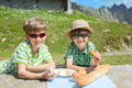 Two boys in summer mountains have got pic nic Royalty Free Stock Photography