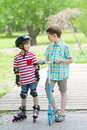 Two boys walk in city park Royalty Free Stock Photo