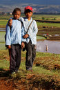 Two boys on the way to school through the rice fields Royalty Free Stock Photo