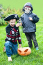Two boys wearing halloween costumes Stock Photos