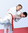 Two boys with white and red belt perform throw  judo Royalty Free Stock Photos