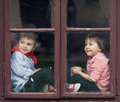 Two boys on the window, laughing and drinking tea Royalty Free Stock Photo
