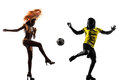 Two brazilians soccer football player samba dancer brazilian men and women in silhouette studio on white background Royalty Free Stock Photography