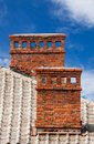 Two brick chimneys on an abandoned house Royalty Free Stock Photo