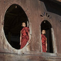 Two brothers novice monks enjoy morning sun shwe yaunghwe kyaung monastery nyaungshwe near inle lake shan state central myanmar Stock Image