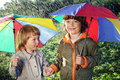 Two brothers play in rain outdoors Royalty Free Stock Photos