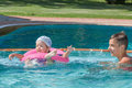 Two brothers playing in the pool Royalty Free Stock Photo