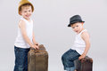 Two brothers posing with huge suitcases leather Stock Photography