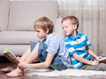 Two brothers are reading books. Royalty Free Stock Images