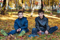 Two brothers sitting on the ground Royalty Free Stock Photo