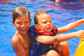 Two brothers in swimming pool at the water park Royalty Free Stock Image