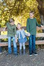 Two brothers and their little sister Royalty Free Stock Photo