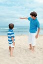 Two brothers on walk near sea outdoor Stock Photography