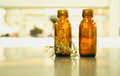 Two brown bottle with flower herb Royalty Free Stock Photo