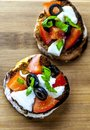 Two bruschettas on cutting board from above Royalty Free Stock Photo