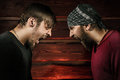 Two brutal man men looking into each other s eyes Stock Photography
