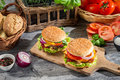Two burgers made ​​from fresh vegetables old wooden table Stock Photo