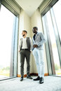Two business colleagues at meeting in modern office interior. Royalty Free Stock Photo