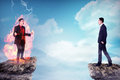 Two business man standing on the top of the mountain Royalty Free Stock Photo