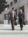 Two Business Men Walking On City Street Royalty Free Stock Photo