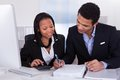 Two business people doing finance work Royalty Free Stock Photo