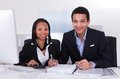 Two Business People Doing Fina...