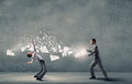 Two business people fighting with each other young businessman trying to evade from thrown paper documents Royalty Free Stock Photo