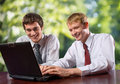Two business people on laptop Royalty Free Stock Photography