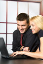 Two business people on laptop Royalty Free Stock Image