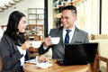 Two business people look happy while having a coffee break Royalty Free Stock Photo