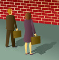 Two business people stopped brick wall dead end Royalty Free Stock Image