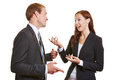 Two business people talking to each engaged other and using their hands Royalty Free Stock Image
