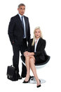 Two business people waiting for an apointment Royalty Free Stock Photo